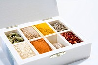 Variety of spices in wooden box, close_up