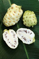 Noni, whole and halved