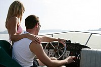 young couple, con, driving, yacht, trip, portrait
