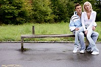 teenage couple, thoughtful, sitting, bench, young