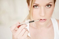 Young, woman, applying, lip gloss, face, fresh, be (thumbnail)