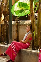 Dai minority girl under a parasol in Yunnan China