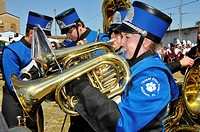 High school band member plays french horn at Strawberry Festival Parade, Plant City, Florida, USA