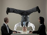 Business man standing on head