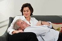 Man resting head on wife´s lap
