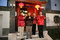 Chinese family making a wish with hands clasped