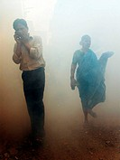 People in the street after pest control fumigation, Mumbai, Maharashtra, India