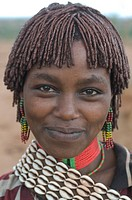 Pretty young Hamer girl at the jumping of the bull ceremony Ethiopia Africa