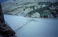 Gigantic suspension bridge in the karakorum mountains near Passu on the Karakorum Highway Northern Pakistan asia