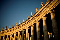 The setting sun warms the columns of Gian Lorenzo Bernini´s colonnade in the Piazza of Saint Peter, Vatican City, Italy. The colonnade consists of 284...