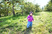 Young girl in an orchard with apple trees in background, Quebec city