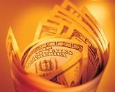 Roll of US dollar bills, paper currencies