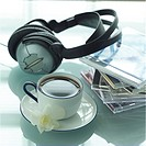 Headphones, cup of coffee, CD cases