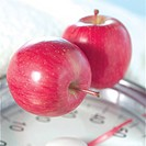 Apples on clock, close_up