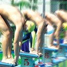 Men at starting block for swimming race