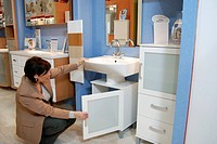 Woman buying bathroom furnishing