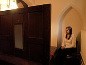 Young Person in a Confessional Box