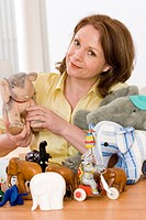 Woman presenting collection of plushies