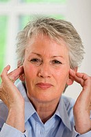 Older female person suffering from headaches