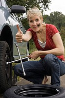 Woman changing tyres