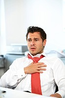 Businessman suffering from heart problems