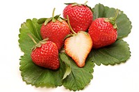 Strawberries grouped and separated with leaves