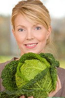 Woman holding savoy cabbage