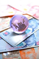 Crystal globe and Singapore banknote