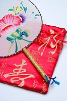Fan and red embroidered Chinese silk bag