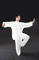 Man doing Tai Chi in studio shot