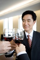 Businesspeople toasting glasses in office
