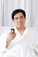 Senior man listening music from mobile phone