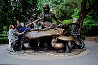 Kids play on ALICE IN WONDERLAND STATUE in CENTRAL PARK _ NEW YORK CITY. NEW YORK
