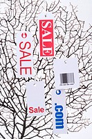 Tree with sale sign, com and bar code
