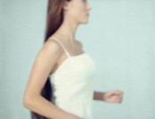 Young woman running, close_up of mid section, defocused, side view