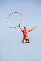 11 year old girl jumps high with hoop, Winnipeg, Canada