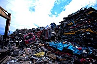 Stacks of compressed cars in a junkyard