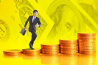 Man running on a stack of golden coins in background of money paper