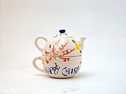 Child Aged Eighteen Months Old Handprints on Teapot