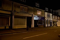 Street Scene at Night with shop lights off Cheam Surrey England