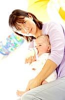 Woman bottle_feeding her baby