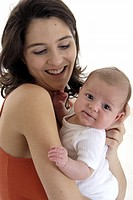 Woman and baby laughing