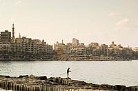 fisherman at the waterfront at the Mediterranian sea, Alexandria, Egypt