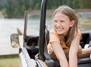 Girl riding in jeep