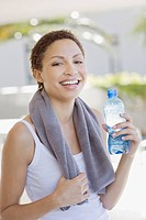 Tired woman drinking water