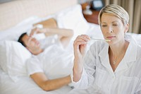 Woman taking husband temperature