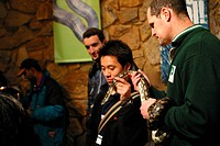 Tourists thke photographs of a snake at a Melbourne Sanctuary.Photography David Ewing