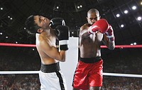 Two men Boxing with one being hit