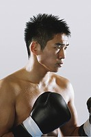 Japanese boxer wearing gloves and sweating (thumbnail)