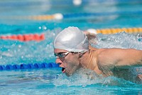 Young athlete doing butterfly stroke (thumbnail)